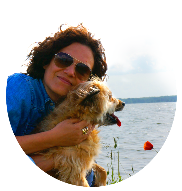 Jacqueline Abromeit freelance book cover designer with her dog Bunny